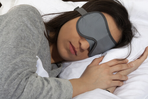a mom sleeping with a blindfold