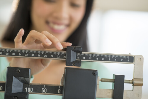 a mom using a weight scale