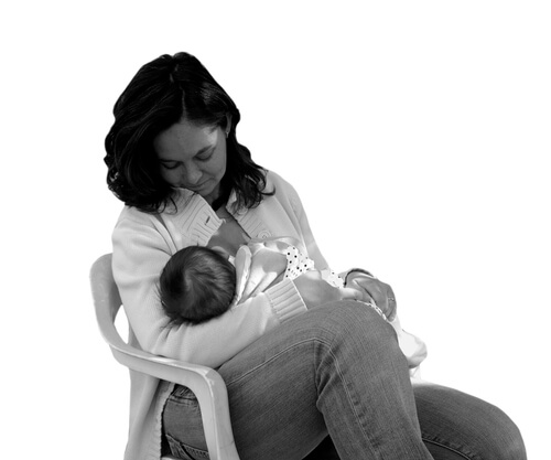 a mom holding her newborn baby
