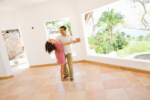 a couple dancing at home