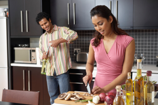 a couple preparing a dinner at home together