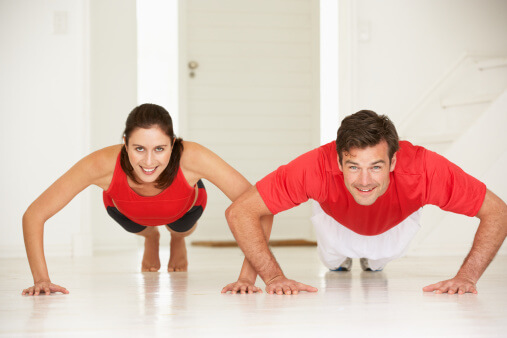 a couple doing push ups together