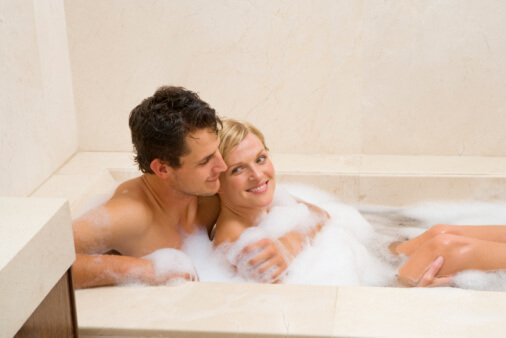a couple taking a bath together