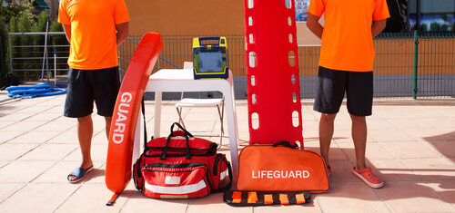 two lifeguards standing on guard