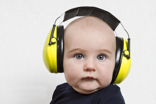 a child wearing ear protectors