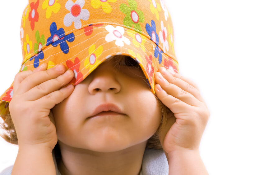toddler wearing a colorful hat