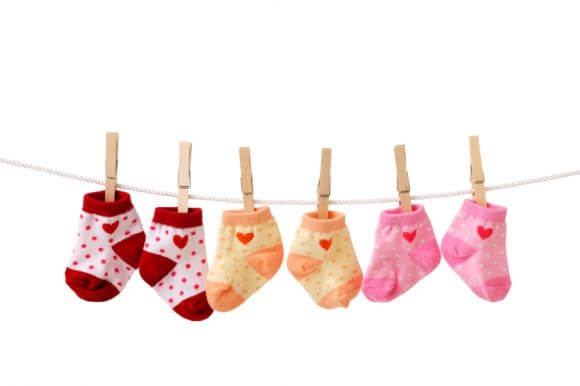 baby socks hanging on a line