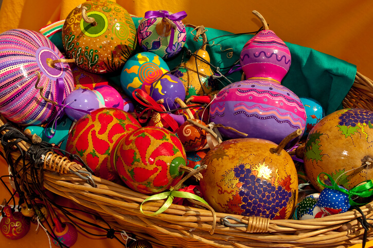 a basket of painted gourds