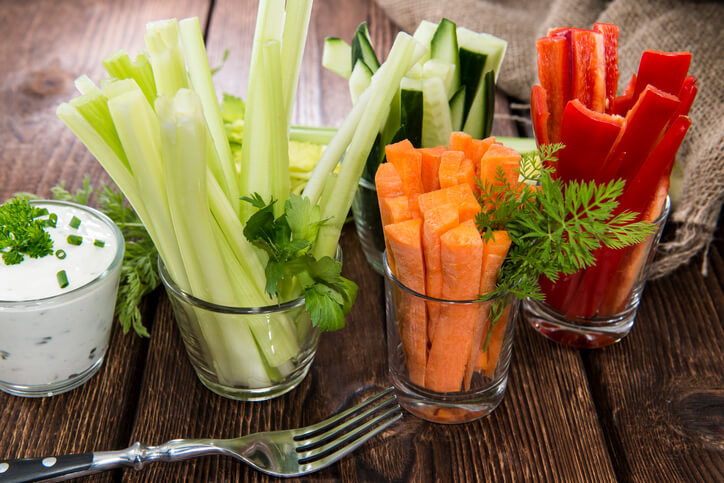 Fresh vegetables in clear glasses and white dip