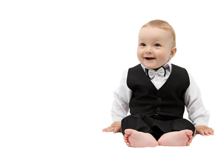a baby dressed in a tuxedo