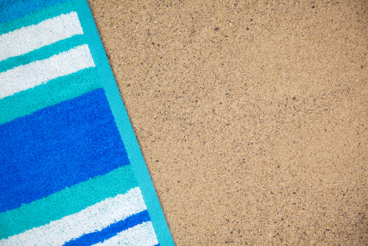 a beach blanket on the sand