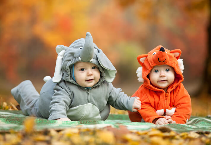 two babies in halloween costumes