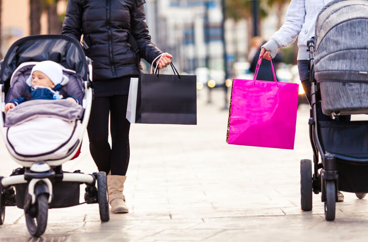 Mothers with strollers shopping in the city