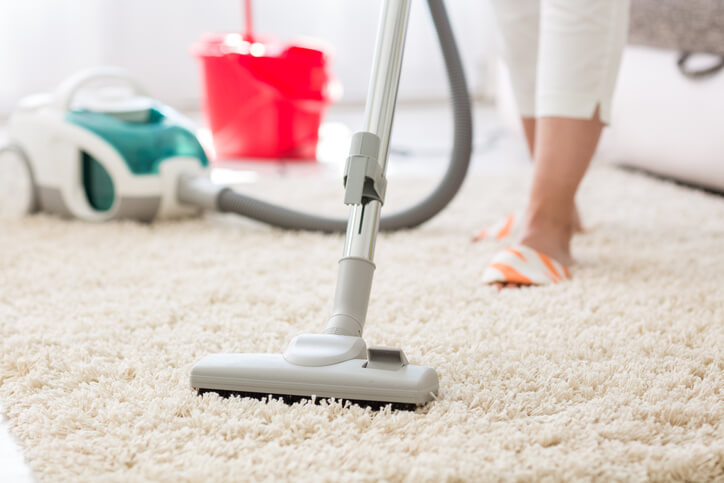a person using a vacuum cleaner