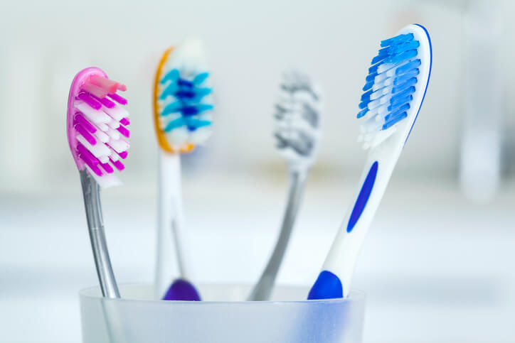 toothbrushes sitting in a cup