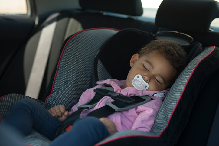 Cute baby sleeping in car chair