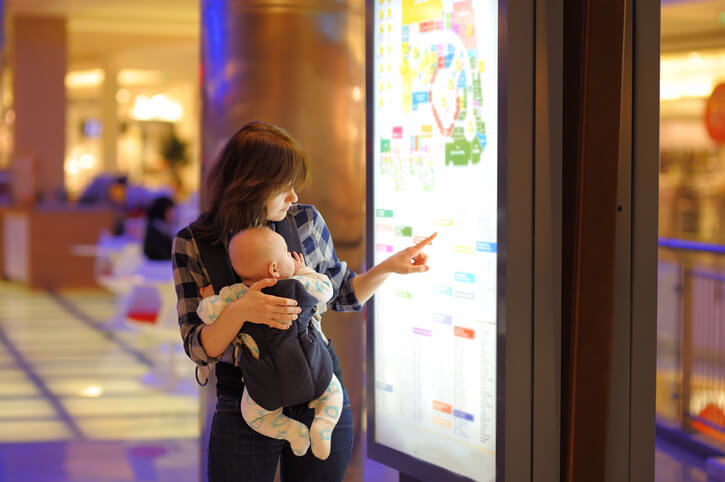 Woman with her baby in a shopping mall
