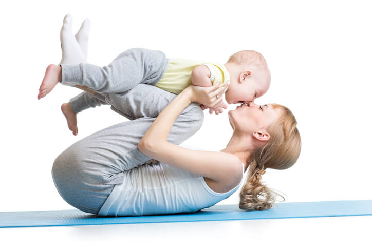 a mom doing yoga with her baby