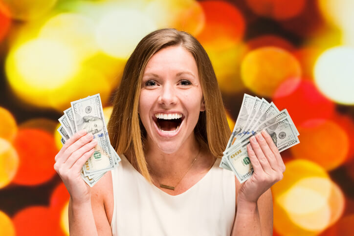 a woman holding up cash