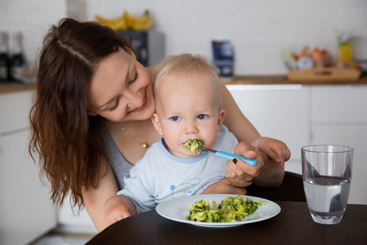Mother and child eating together