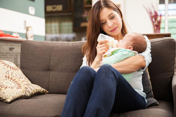 Woman feeding formula to her baby