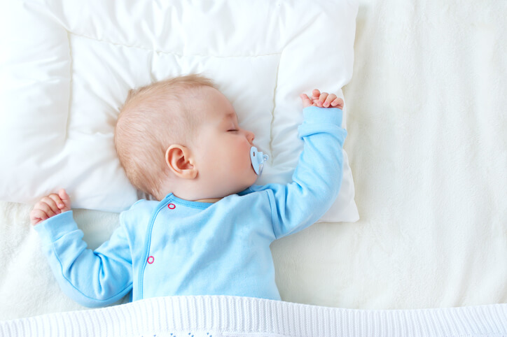 a baby sleeping with a pacifier