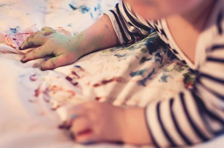 Hands of a baby artist
