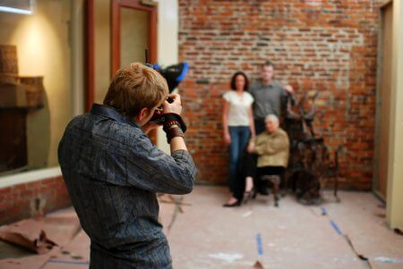 a photographer taking a photo of a family