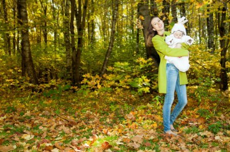 a woman in a forest with her baby