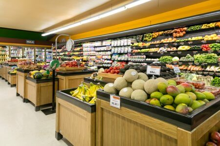 Produce section in grocery store wide angle