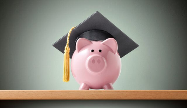 Piggy bank with graduation cap on the shelf.