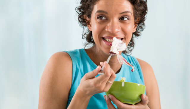 Woman eating healthy salad.