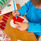 Kids, children, doing Valentine's day arts and crafts with hearts, pencils, paper