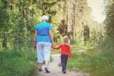 happy grandmother with little granddaughter walk in nature