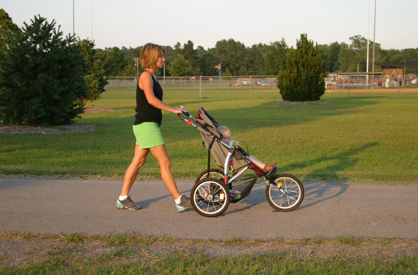 a mom pushing her baby in a stroller