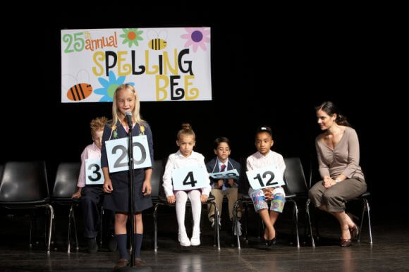 a group of kids competing in a spelling bee