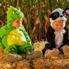 two toddlers dressed in costume