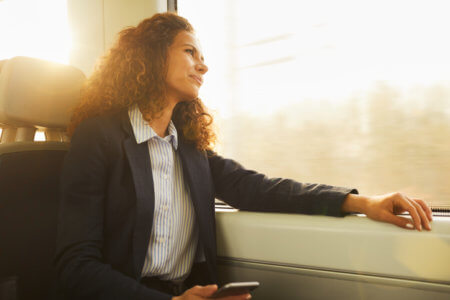 Businesswoman on the move on a train